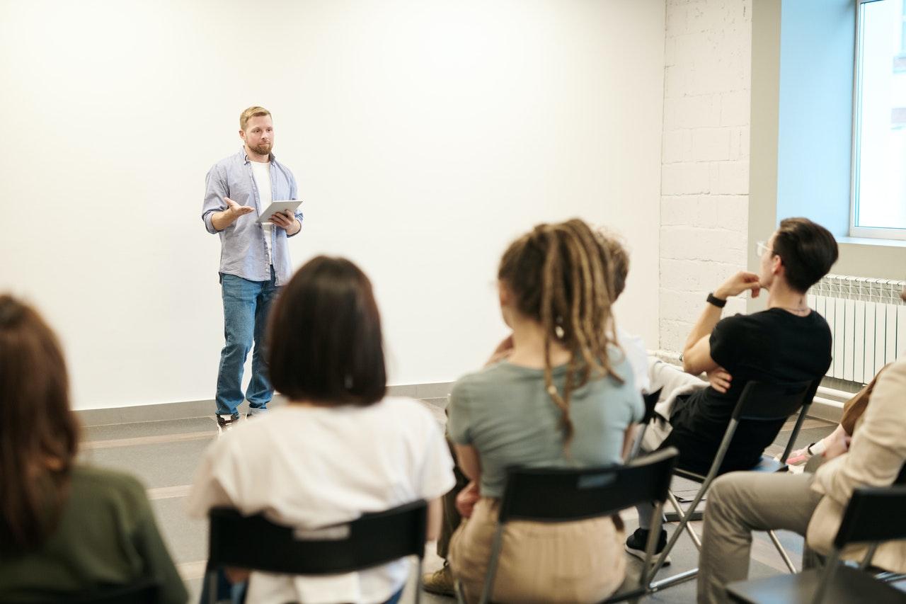 man speaking to audience